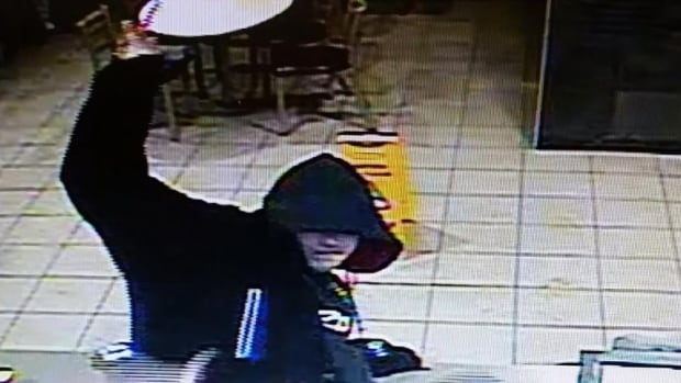 The suspect in the attempted robbery at Campbellton's McDonald's is described as being of medium height and clean shaven.