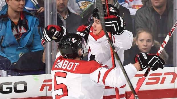 Canada's Travis Konecny, right, celebrates with teammate Thomas Chabot after scoring against Finland during the quarter-final at the IIHF World Junior Championship in Helsinki, Finland.
