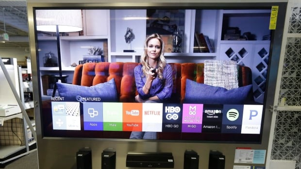 In this August 2015 photo, a Samsung Smart TV is for sale in Sacramento, Calif. Research has shown that roughly a third of smart TVs in the U.S. weren't connected to the internet and that many users opt for stand-alone streaming devices that do a better job.