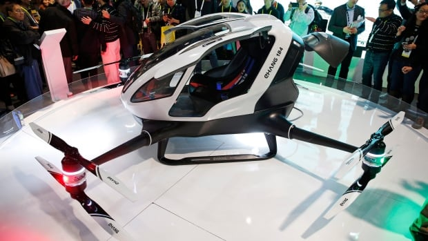 The EHang 184 autonomous aerial vehicle is unveiled at the EHang booth at CES International on Wednesday in Las Vegas. EHang Inc says it is the world's first drone capable of carrying a human passenger.