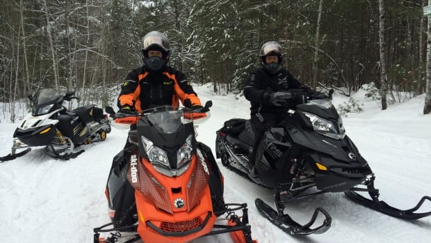 Ryan Downing of the Osgoode Carleton Snowmobile Trail Club (left) is warning snowmobilers to stay off the region's network of trails until surface conditions improve.