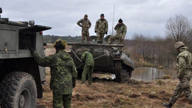 Canadian soldiers train alongside Ukrainian soldiers at the International Peacekeeping and Security Centre in Starychi, Ukraine, in November 2015 as part of Operation Unifier