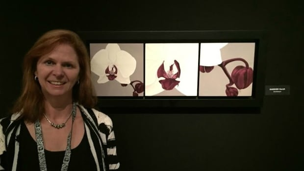 """Hamilton neuropsychiatrist Sarah Garside with her painting, """"Orchidesque,"""" which was on display at The Louvre in Paris in Dec. 2015."""