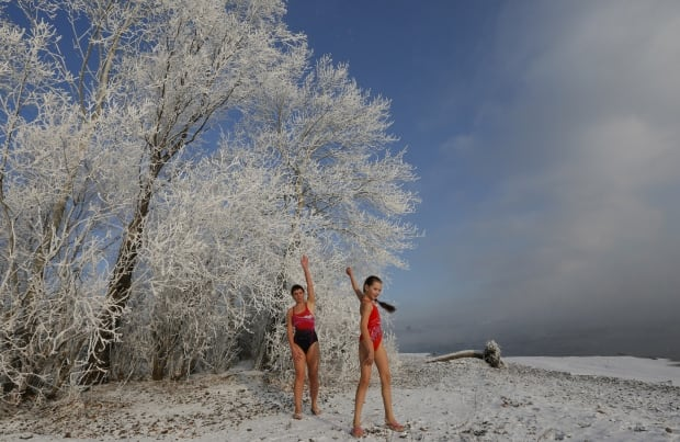 Cryophile swim club members stretch before going in the Yenisei on Nov 14