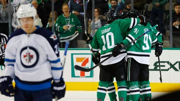 Dallas Stars' Patrick Sharp (10) and Tyler Seguin (91) celebrate Seguin's goal against the Winnipeg Jets during the first period on Thursday, Jan. 7, 2016, in Dallas.