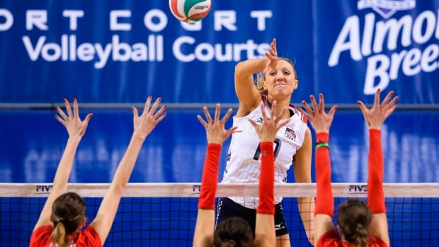 United States' Jordan Larson-Burbach (10) spikes the ball against Canada's Rebecca Pavan (15), Jaimie Thibeault (8) and Dana Cranston (20) in a women's volleyball NORCECA round-robin Olympic qualifying tournament match in Lincoln, Neb., on Thursday, Jan. 7, 2016.