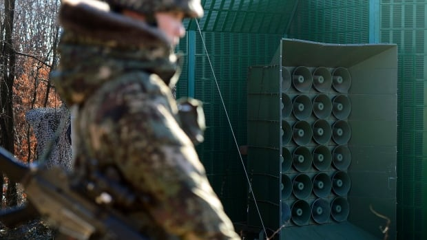 A South Korean soldier on Friday stands near the loudspeakers near the border area near North Korea in Yeoncheon, South Korea.