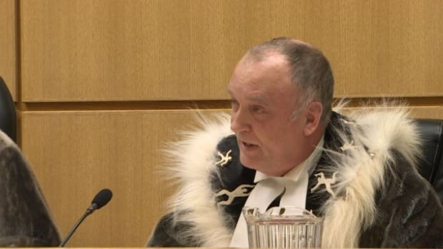 Nunavut Justice Robert Kilpatrick presiding over the appointment of the territory's newest judge. If the federal government doesn't appoint more judges to Nunavut's bench to fill vacancies, he says, some circuit courts may be cancelled this year.
