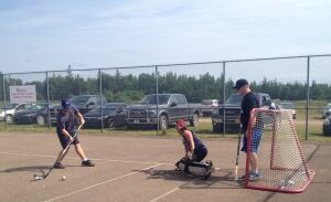 Morgan MacIntyre (left) and Logan MacIntyre (right) memorial ball hockey tournament