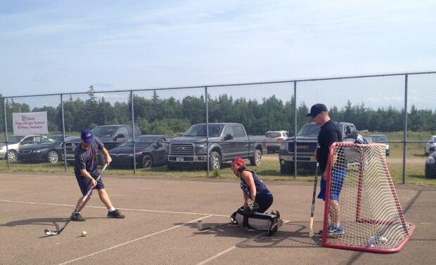 Morgan MacIntyre (left) and Logan MacIntyre (right) memorial ball hockey tournament