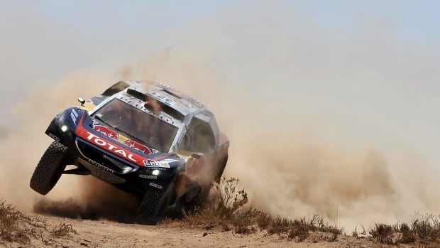 French driver Cyril Despres and co-driver David Castera punch their Peugeot through sand during Stage 6 of the 2016 Dakar Rally race on Jan. 8.