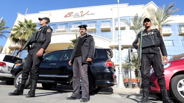 Security personnel guard the entrance to the Bella Vista hotel after two knife-wielding assailants wounded three foreign tourists.