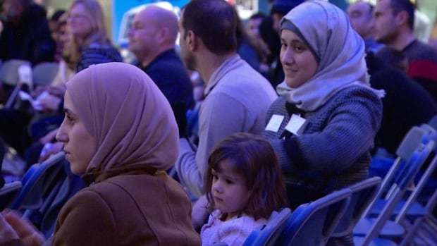 A large crowd attended a welcoming event at Edmonton's City Hall on Friday.