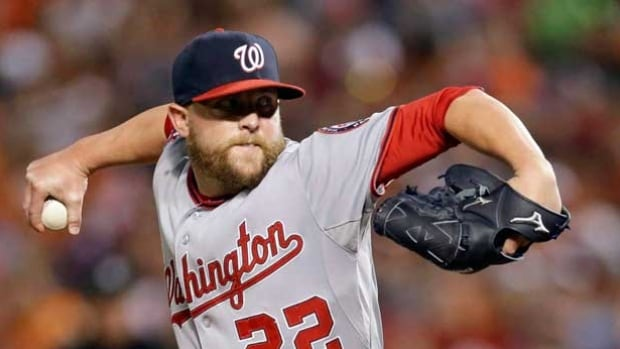Drew Storen, pictured playing for the Washington Nationals, throws to the Baltimore Orioles in July 2015. The Toronto Blue Jays have added to their bullpen by acquiring Storen from the Nationals.