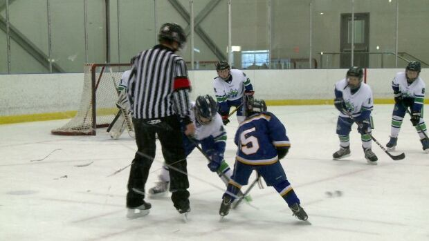 Players face off Saturday during a Minor Hockey Week game at Terwilligar Recreation Centre.