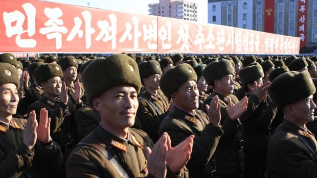 North Korean military personnel clap at a rally at the Kim Il-sung Square in Pyongyang on Friday, Jan. 8, 2016. The country's widely disputed claim of a successful hydrogen bomb test earlier this week has drawn global outrage, but serves as a rallying point for leader Kim Jong-un.