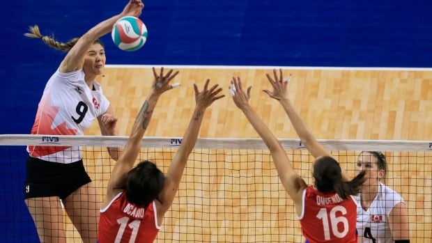 Canada's Tabitha Love (No. 9, left) drives home a winning shot against Puerto Rico but Canada fell for a third time in the NORCECA Olympic qualifying tournament and will not qualify to go to the 2016 Olympics in Rio.