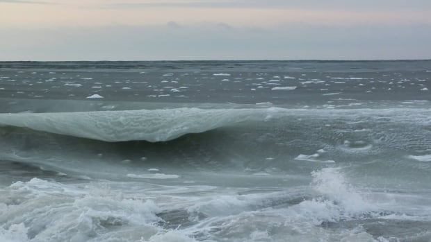 'Icy backside tubes of death,' Girard-Lemay says of these waves that are partly frozen in Rimouski.