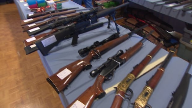 Guns are displayed for sale at a show in Regina. A Winnipeg man has plead guilty to gun trafficking.