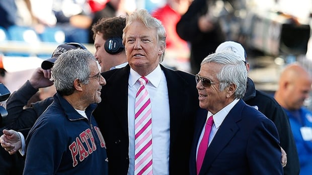 Donald Trump, middle, with New England Patriots owner Robert Kraft, right, before a Patriots game in 2012.