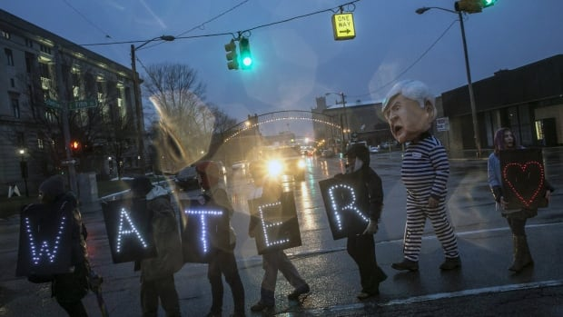 More than 150 protesters stand outside of Flint's City Hall on Jan. 8 to protest Michigan Gov. Rick Snyder's handling of the water crisis.