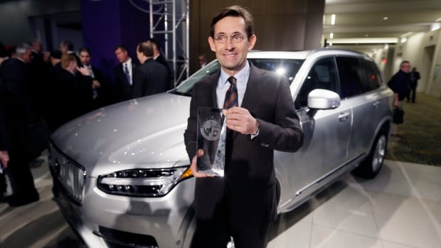 Volvo Car USA Senior Vice-President Americas President and CEO Lex Kerssemakers stands next to the Volvo XC90 after winning the truck/utility of the year at the North American International Auto Show on Monday.