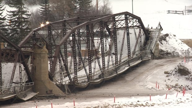 The Traffic Bridge waits to be broken apart after being blown off its piers in the South Saskatchewan River in Saskatoon.