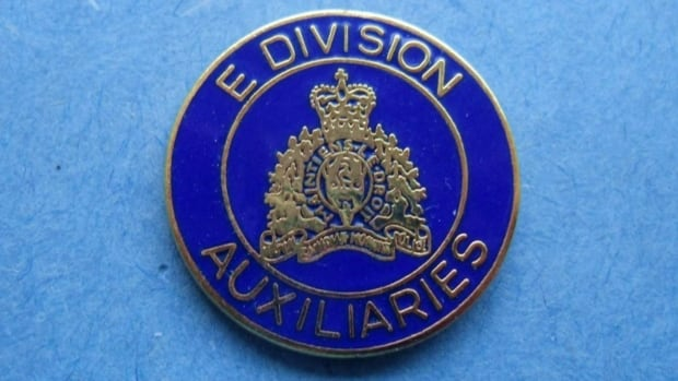 A lapel badge for an RCMP auxiliary constable stationed in B.C. A Vernon city councilor wants auxiliary police to get the same tax credit that volunteer firefighters and search and rescue volunteers receive.