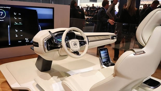 """The interior of Volvo's Concept 26 autonomous vehicle. When a """"relaxation mode"""" is activated, the driver's seat reclines to a nearly flat position and the vehicle's sensors take over the wheel."""