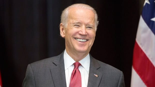 Vice President Joe Biden, seen at a Dec. 15 event, described Bernie Sanders on Monday as more authentic on economic inequality than Hillary Clinton and defended Sanders' record on gun control during an interview with CNN.