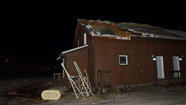 At least one house was extensively damaged in Pangnirtung Monday night, when the roof was ripped off and the oil tank blew over.