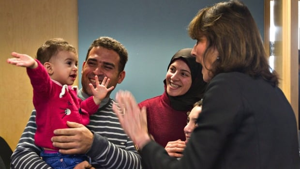 Quebec Immigration Minister Kathleen Weil greets members of a Syrian family as she meets refugees at  Cégep de Sainte-Foy, in Quebec City.