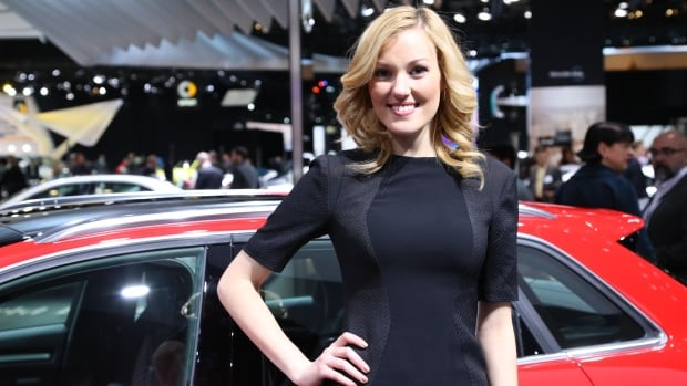 A model stands at the Audi booth for the A3 e-tron at the North American International Automotive Show in Detroit. Auto manufacturers at the exhibition now employ a mix of models and product specialists to inform would-be consumers about the latest car specs.