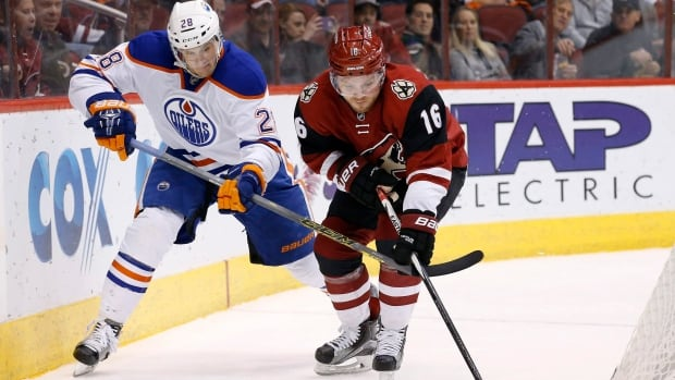 Coyotes' Max Domi, right, had a breakout night against Lauri Korpikoski and the Oilers, scoring his first NHL hat trick as Arizona edged Edmonton 4-3 in overtime.