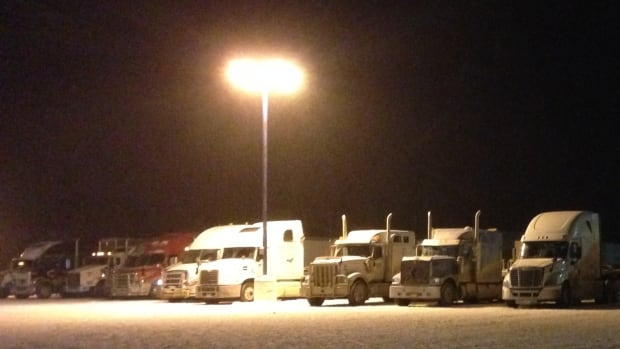 "Dozens of transport trucks lined up at the Husky Truck stop in Nipigon, Ont., after the Nipigon River Bridge was damaged. Cars and most trucks are crossing the bridge about 10 to 15 minutes slower than usual, and officials decide on a ""case-by-case basis"" whether to allow trucks weighing more than 63,500 kilograms over the bridge."