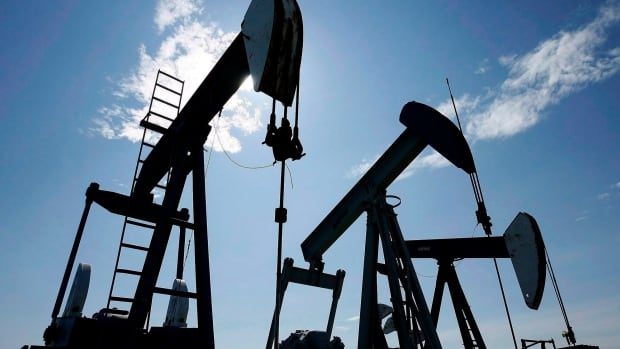 File: Pumpjacks at work pumping crude oil near Halkirk, Alta., June 20, 2007. THE CANADIAN PRESS/Larry MacDougal