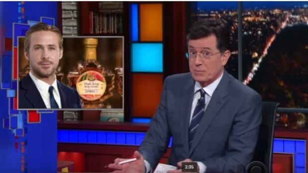 Talk show host Stephen Colbert praises Canada for its maple syrup and Ryan Gosling, but warns Canadians not to buy Powerball lottery tickets.