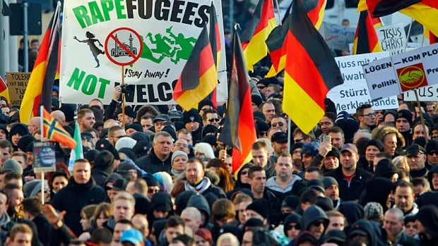 Supporters of the anti-immigrant, right-wing movement PEGIDA (Patriotic Europeans Against the Islamization of the West) demonstrate in Cologne last weekend.