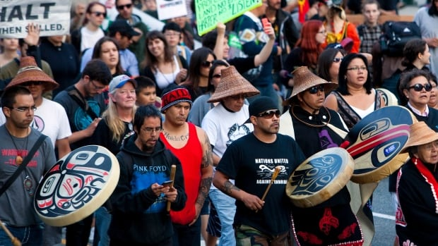 Demonstrators protest on the streets following the federal government's approval of the Enbridge's Northern Gateway pipeline in Vancouver, British Columbia June 17, 2014.