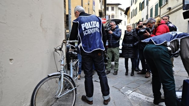 Italian police are shown investigating on Jan. 11 outside the apartment of Ashley Olsen in Florence.