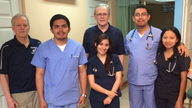 Dr. Rex Dunn (far left) and Dr. Elwood MacMullin (at back) with Guatemalan interns on a prior trip to Guatemala.