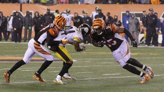 Cincinnati Bengals' Vontaze Burfict (55) runs into Pittsburgh Steelers' Antonio Brown (84) during the second half of an NFL wild-card playoff football game Sunday, Jan. 10, 2016, in Cincinnati.