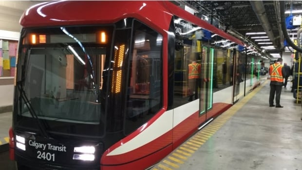 "The new C-Train car with the ""Mask"" design at its unveiling in Calgary."