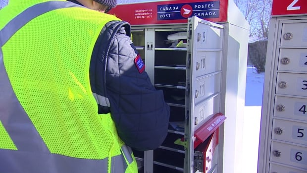 Postal workers now delivering mail to community mailboxes are working a lot of overtime.