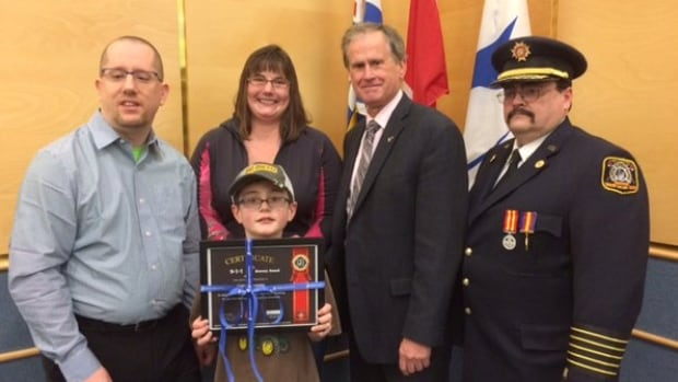 Josef Aschwanden displays his award for bravery given to him by the Cariboo Regional District.