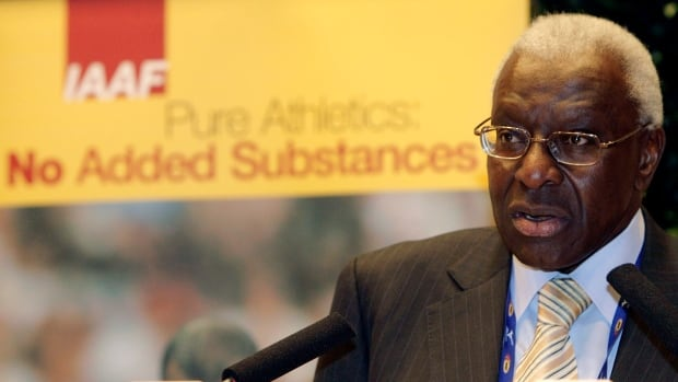 In this 2006 file photo, Lamine Diack, then president of the International Association of Athletics Federation (IAAF), speaks  during the opening ceremony of the IAFF World Anti-Doping Symposium in Lausanne, Switzerland.
