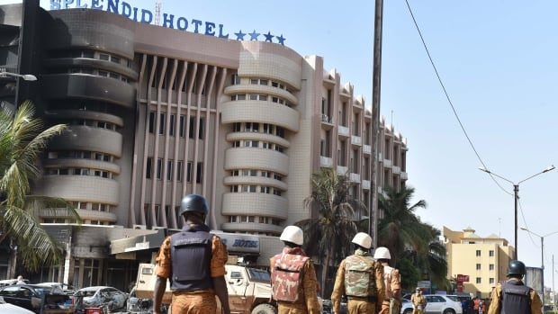 Burkina Faso's troops patrol outside the Splendid Hotel and nearby Cappuccino restaurant following a jihadist attack in Ouagadougou on Jan. 16, 2016.