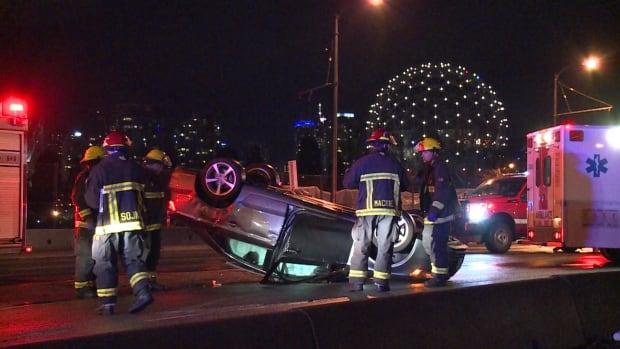 Vancouver firefighters check out a car after the driver escaped a rollover with minor injuries early Sunday morning.