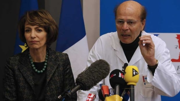 French Health Minister Marisol Touraine and Gilles Hedan, professor of clinical neurology, attend a news conference in Rennes, France, January 15, 2016.