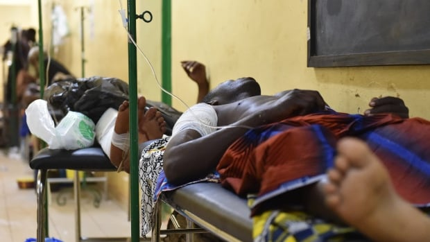 Wounded people rest at the Yalgado Hospital in Ouagadougou following an al-Qaeda attack that killed 28 people.